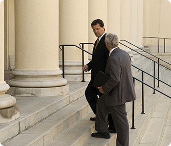 Lawyer & Client on Courthouse Steps Photo